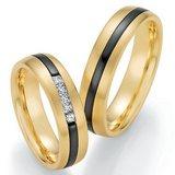 Mooye trouwringen in geelgoud en zirkonium _