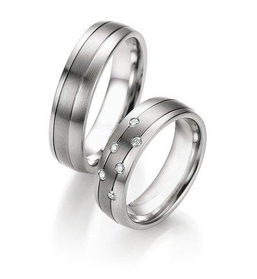 Trouwringen in titanium en edelstaal met diamant(en)per paar