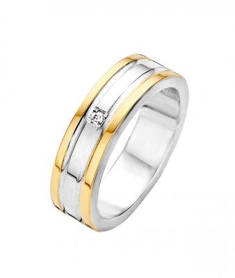 Mooye trouwringen in zilver met goud inclusief diamant per paar