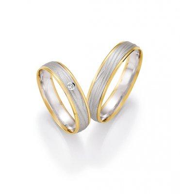 Mooye trouwringen 8 karaat 333 wit met geel per paar