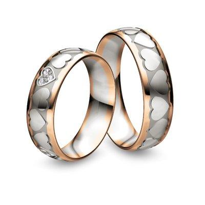 Mooye trouwringen in 18 karaat 750 bicolour witgoud met roségoud met diamant(en)