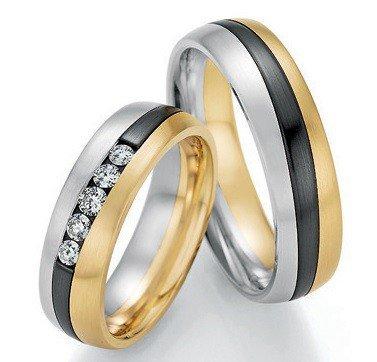 Mooye trouwringen in witgoud met geelgoud en zirkonium