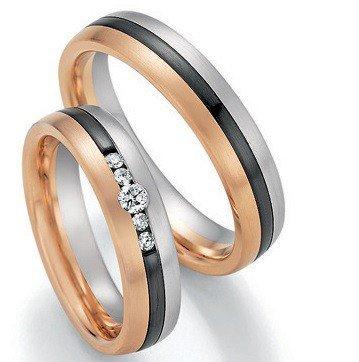 Mooye trouwringen in witgoud met rosé goud en zirkonium