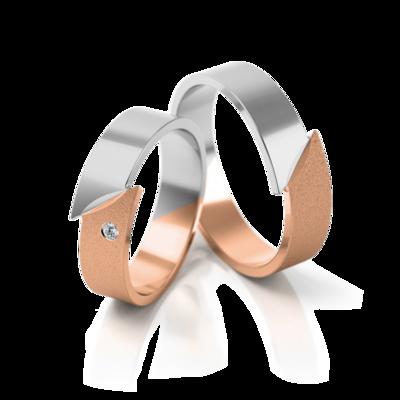 Mooye trouwringen in witgoud en rosé goud met diamant