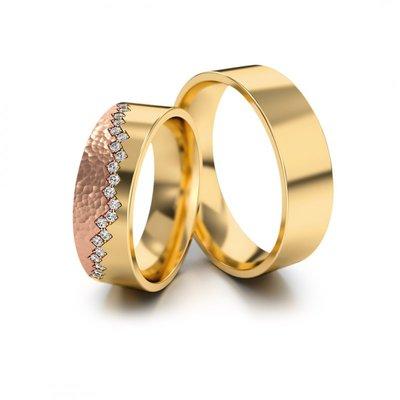 Mooye trouwringen in geelgoud en rosé goud met diamant