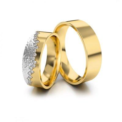 Mooye trouwringen in geelgoud en witgoud met diamant