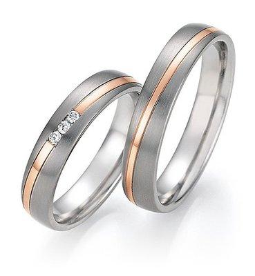 Mooye trouwringen in Titanium en roodgoud met diamant per paar