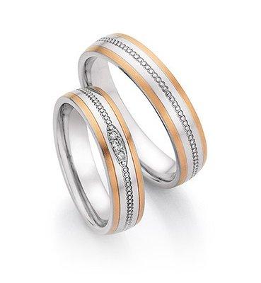 Trouwringen in Edelstaal en roodgoud met diamant(en) per paar