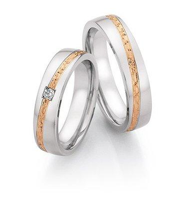 Mooye trouwringen in Edelstaal en roodgoud met diamant(en) per paar