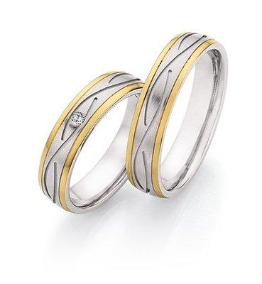 Mooye trouwringen in Edelstaal en geelgoud met diamant(en) per paar