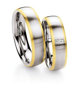 Mooye trouwringen in edelstaal met geelgoud per paar vanaf