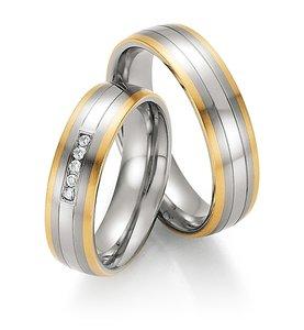 Mooye trouwringen in edelstaal met geelgoud per paar