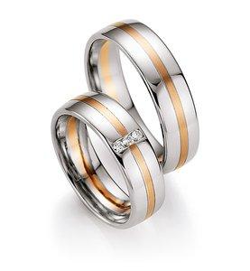Mooye trouwringen 8 karaat 333 wit met rood per paar