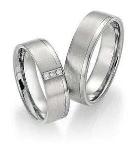 Mooye trouwringen in Titanium en Platina met diamant