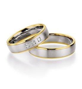 Mooye trouwringen in 14 karaat 485 witgoud met geelgoud per paar