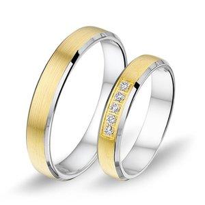 Mooye trouwringen 8 karaat 333 geel met wit en diamanten per paar